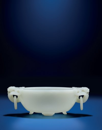 A FINELY CARVED WHITE JADE MAR