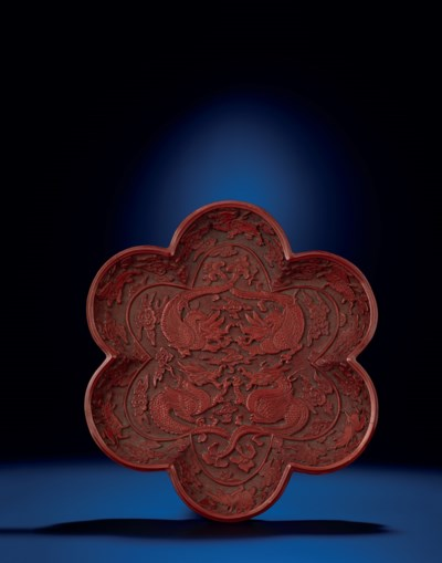 A VERY RARE EARLY MING CARVED