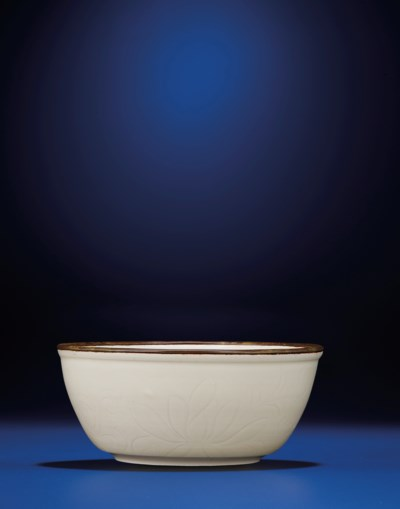 A FINE INCISED DING WARE LOTUS