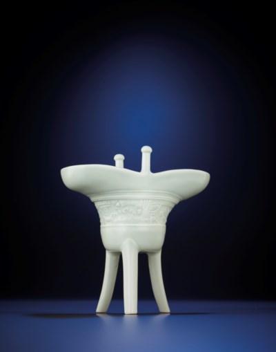 A FINE WHITE-GLAZED MOULDED AR