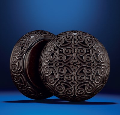 A CARVED BLACK AND RED TIXI LA