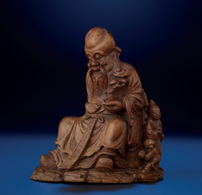 A CARVED BAMBOO FIGURE OF SEAT