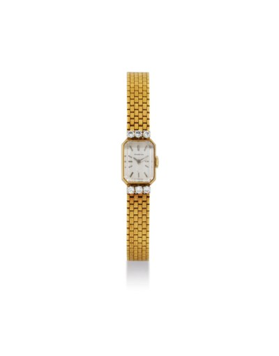 MOVADO. A LADY'S 18K GOLD AND