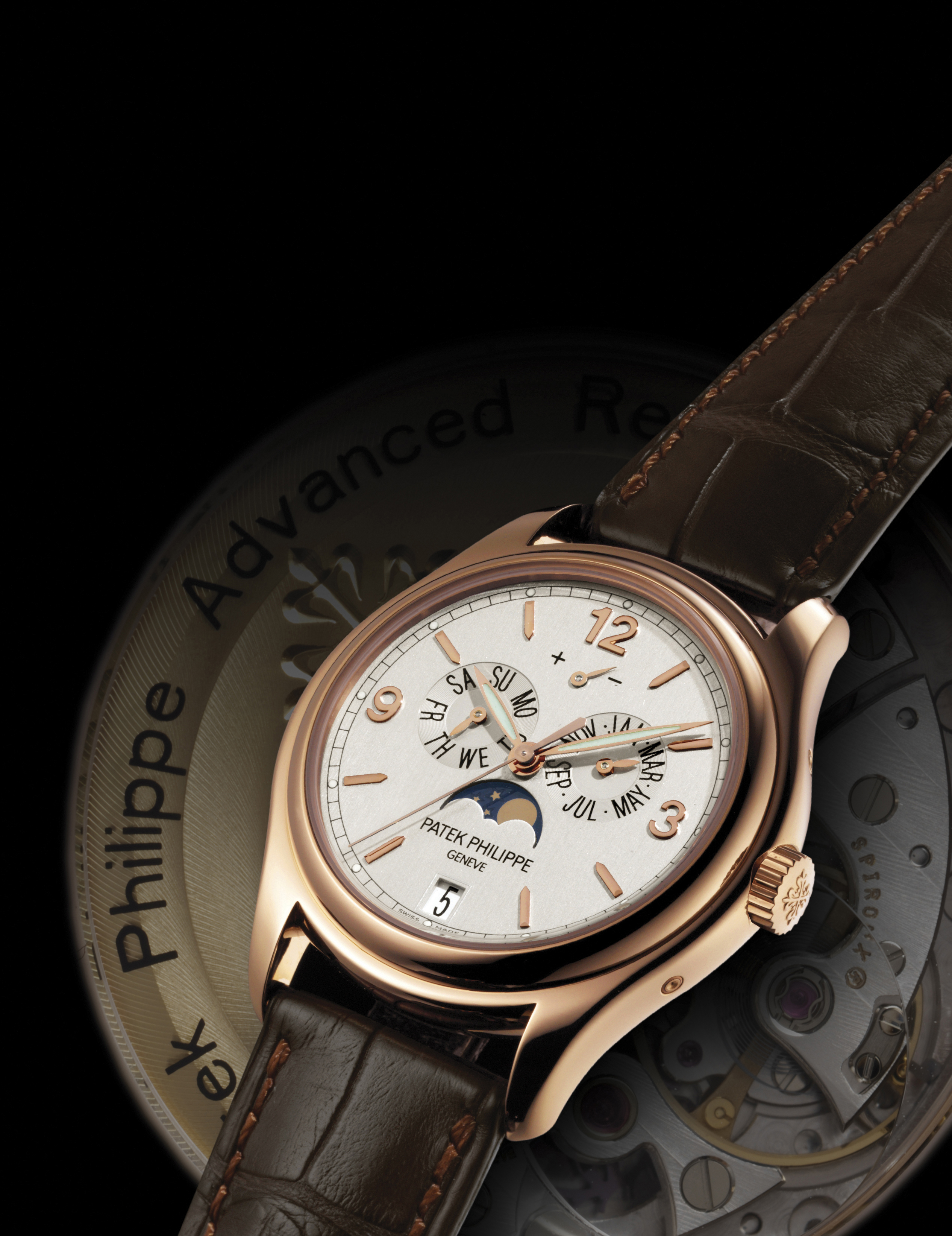 PATEK PHILIPPE. A FINE AND RARE 18K PINK GOLD LIMITED EDITION AUTOMATIC ANNUAL CALENDAR WRISTWATCH WITH SWEEP CENTRE SECONDS, MOON PHASES, POWER RESERVE, SILICON ESCAPE WHEEL AND SILINVAR SPIROMAX BALANCE SPRING, ORIGINAL CERTIFICATE AND BOX