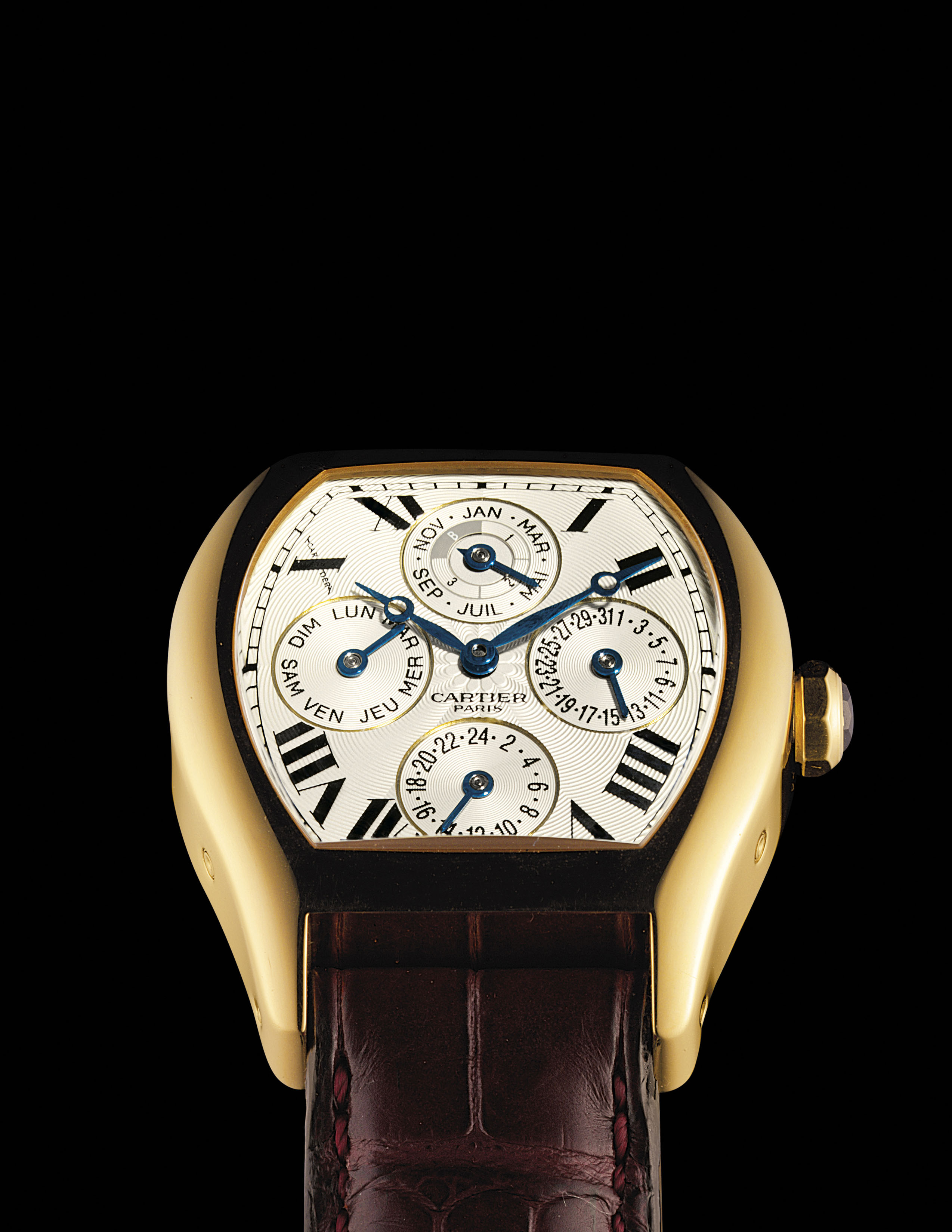 CARTIER. A FINE AND LARGE 18K GOLD TONNEAU-SHAPED AUTOMATIC PERPETUAL CALENDAR DUAL TIME WRISTWATCH