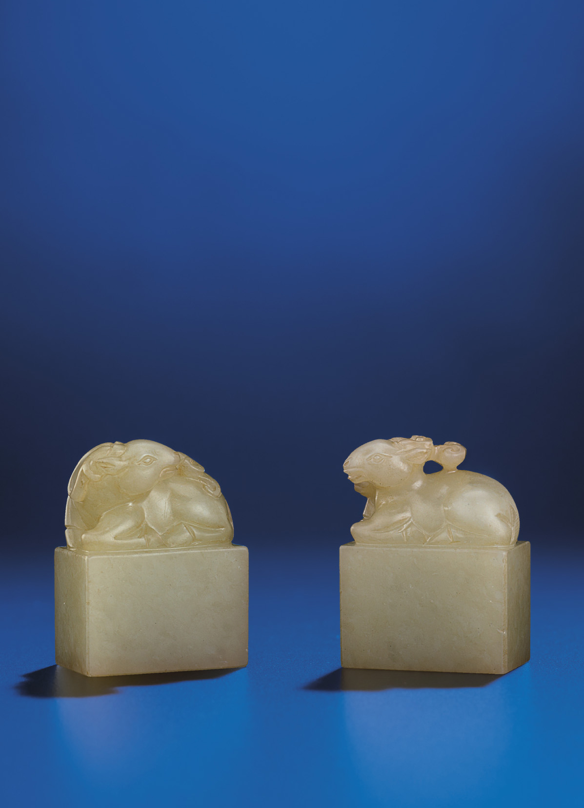 A PAIR OF SMALL PALE CELADON J