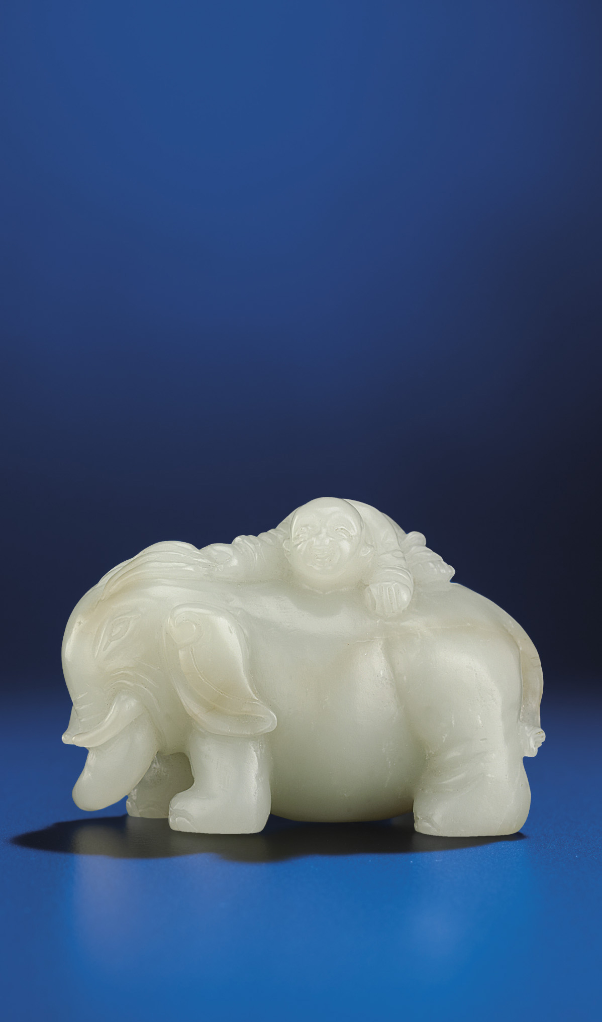 A WHITE JADE CARVING OF A BOY