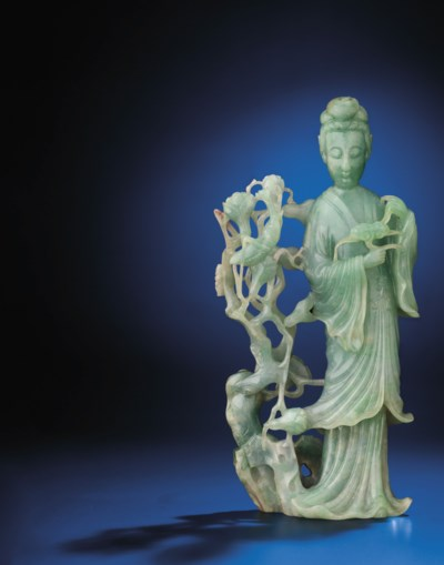 A LARGE FINELY CARVED JADEITE