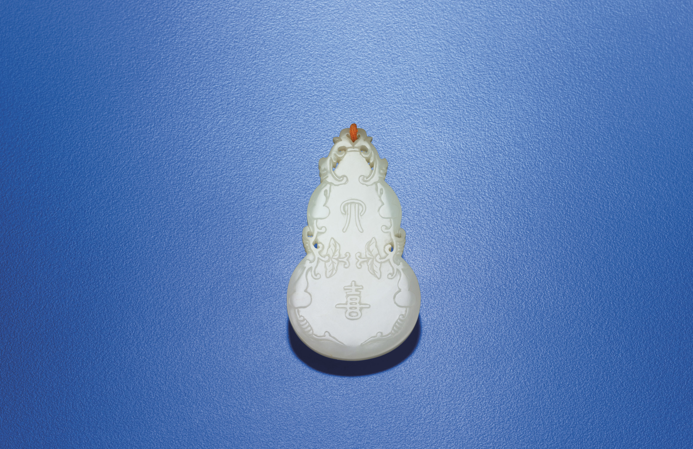 A WHITE JADE DOUBLE-GOURD FORM