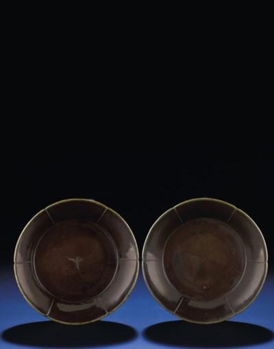 TWO BROWN LACQUER FOLIATE-RIM