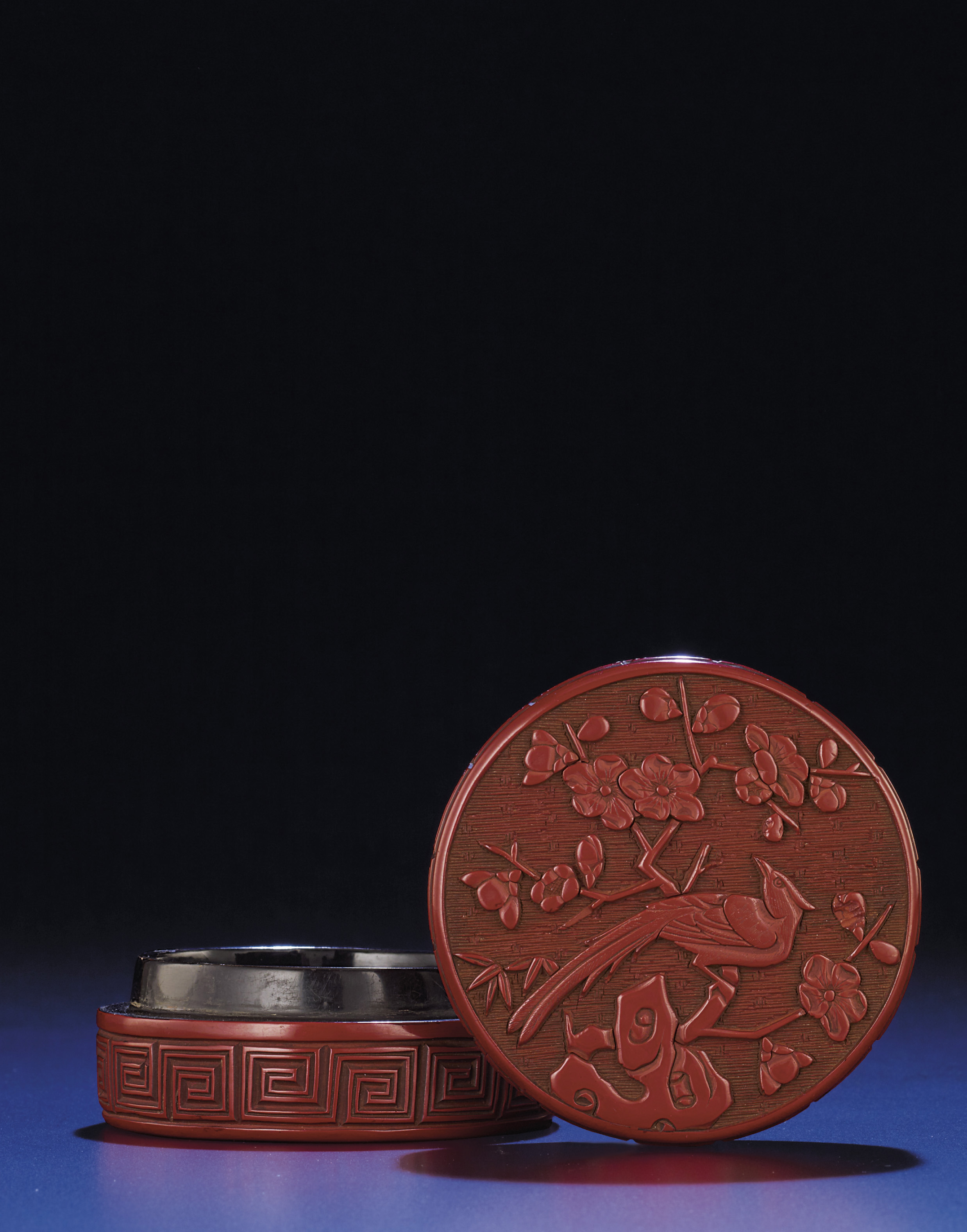 A FINELY CARVED SMALL CINNABAR