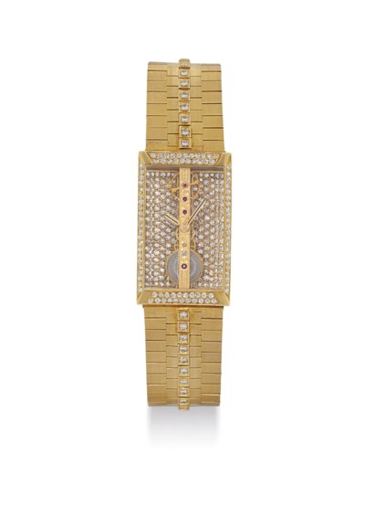CORUM. A RARE 18K GOLD AND DIA