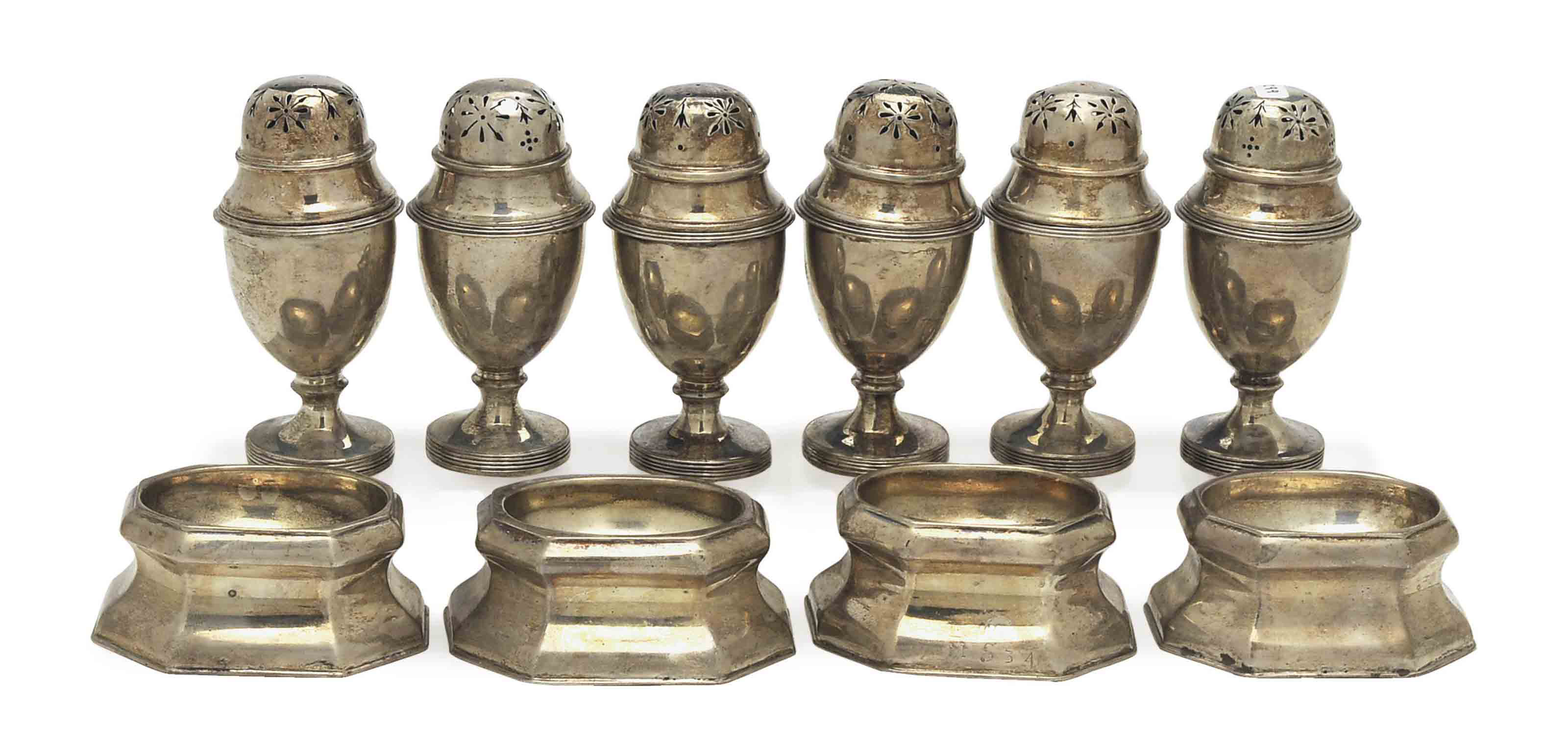 A SET OF SIX GEORGIAN CASTERS AND COVERS AND FOUR GEORGIAN SILVER TRENCHER SALTS,