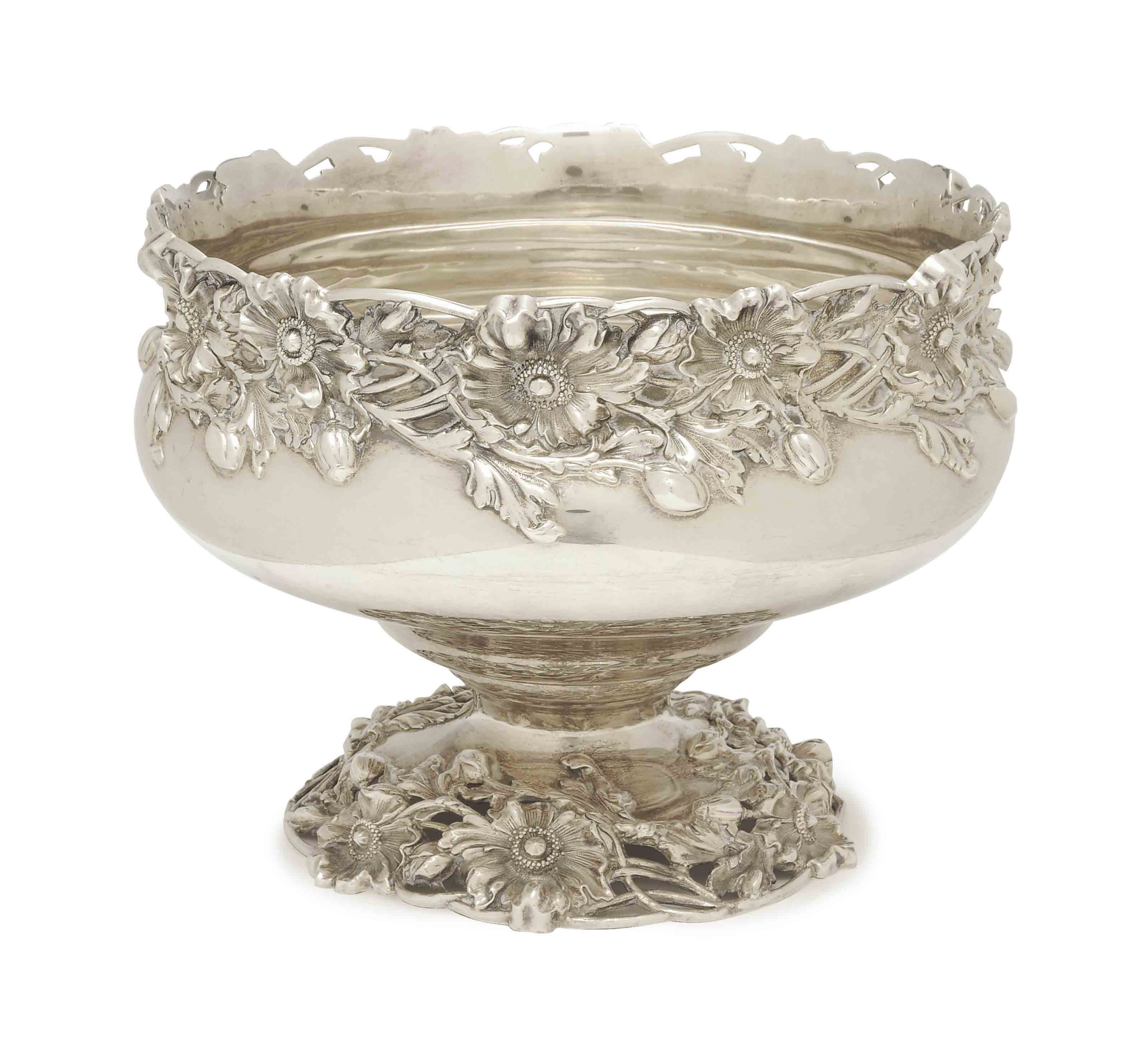 AN AMERICAN SILVER RETICULATED AND REPOUSSE FOOTED PUNCH BOWL,