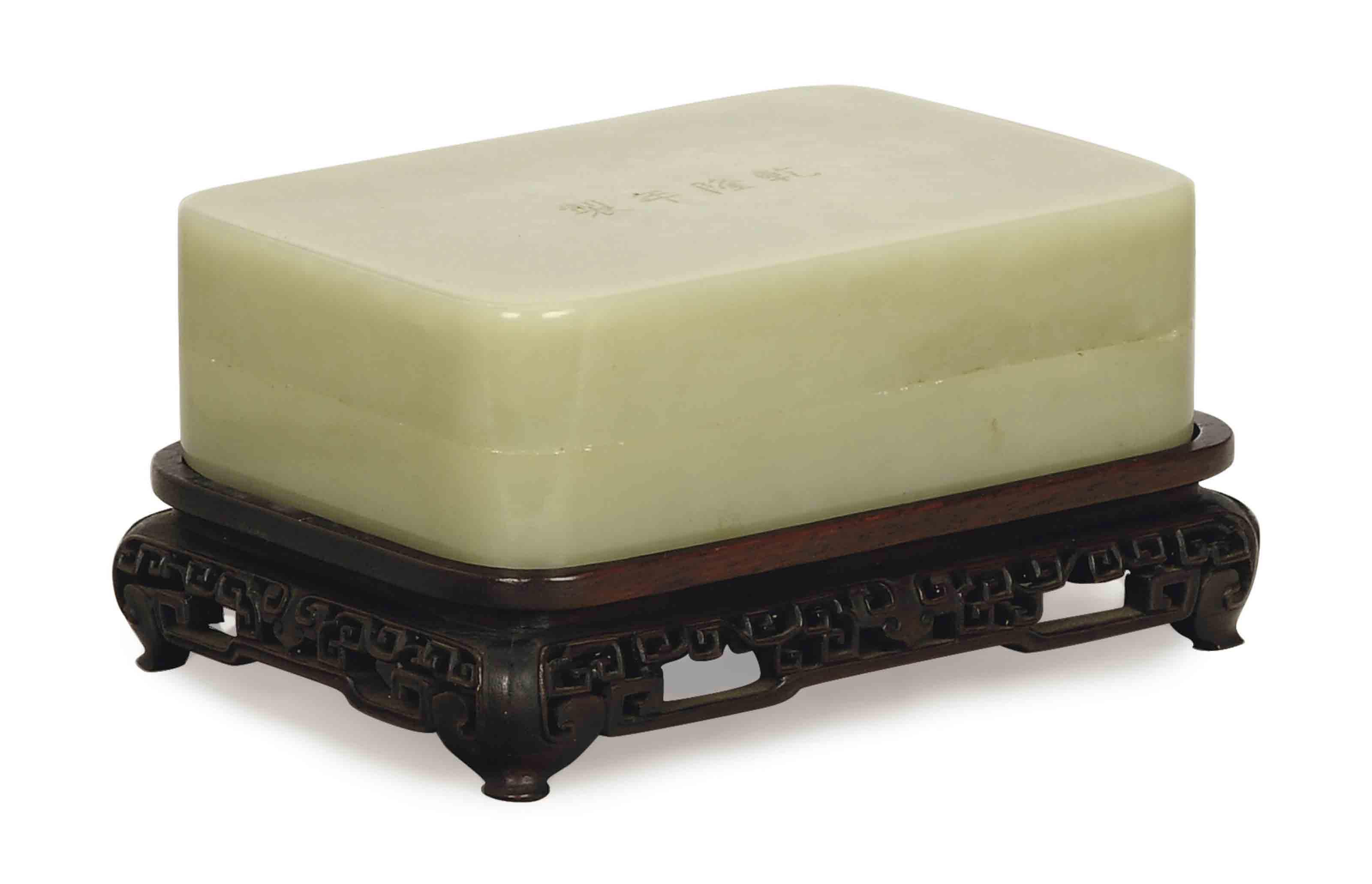 A CHINESE GREENISH JADE BOX AN