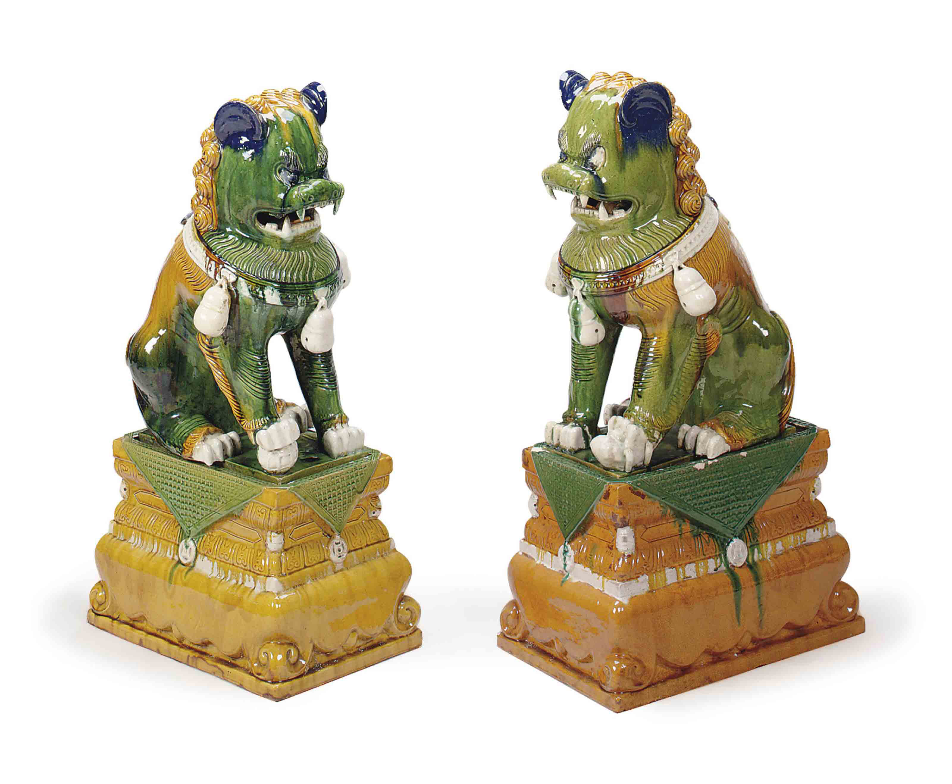 A PAIR OF CHINESE GREEN, OCRE