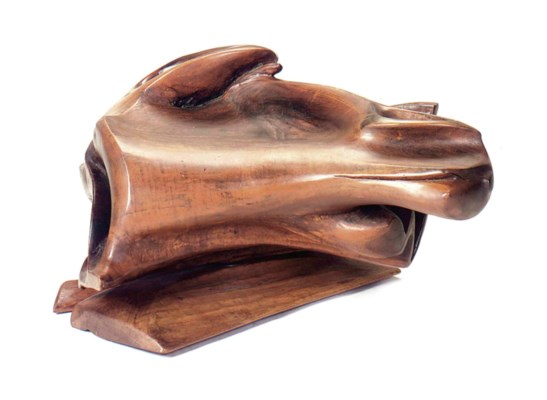 AN ARTISAN CARVED WALNUT SWIVE