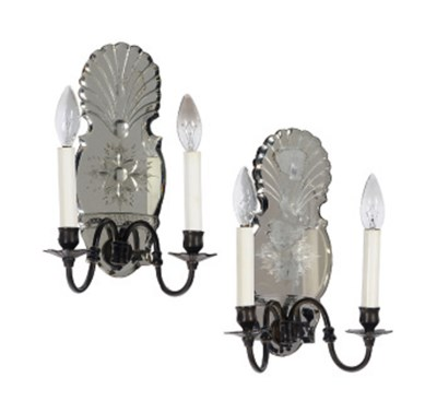 A SET OF FOUR PATINATED-METAL,