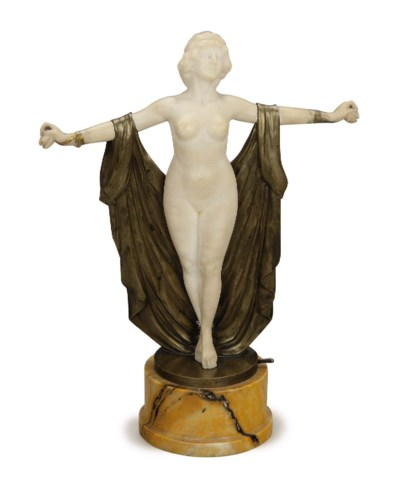 A PATINATED BRONZE AND CARVED