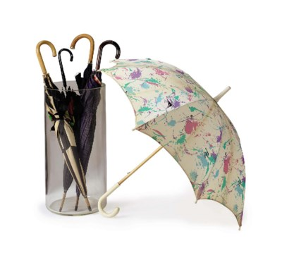 A GROUP OF FIVE PARASOLS IN A
