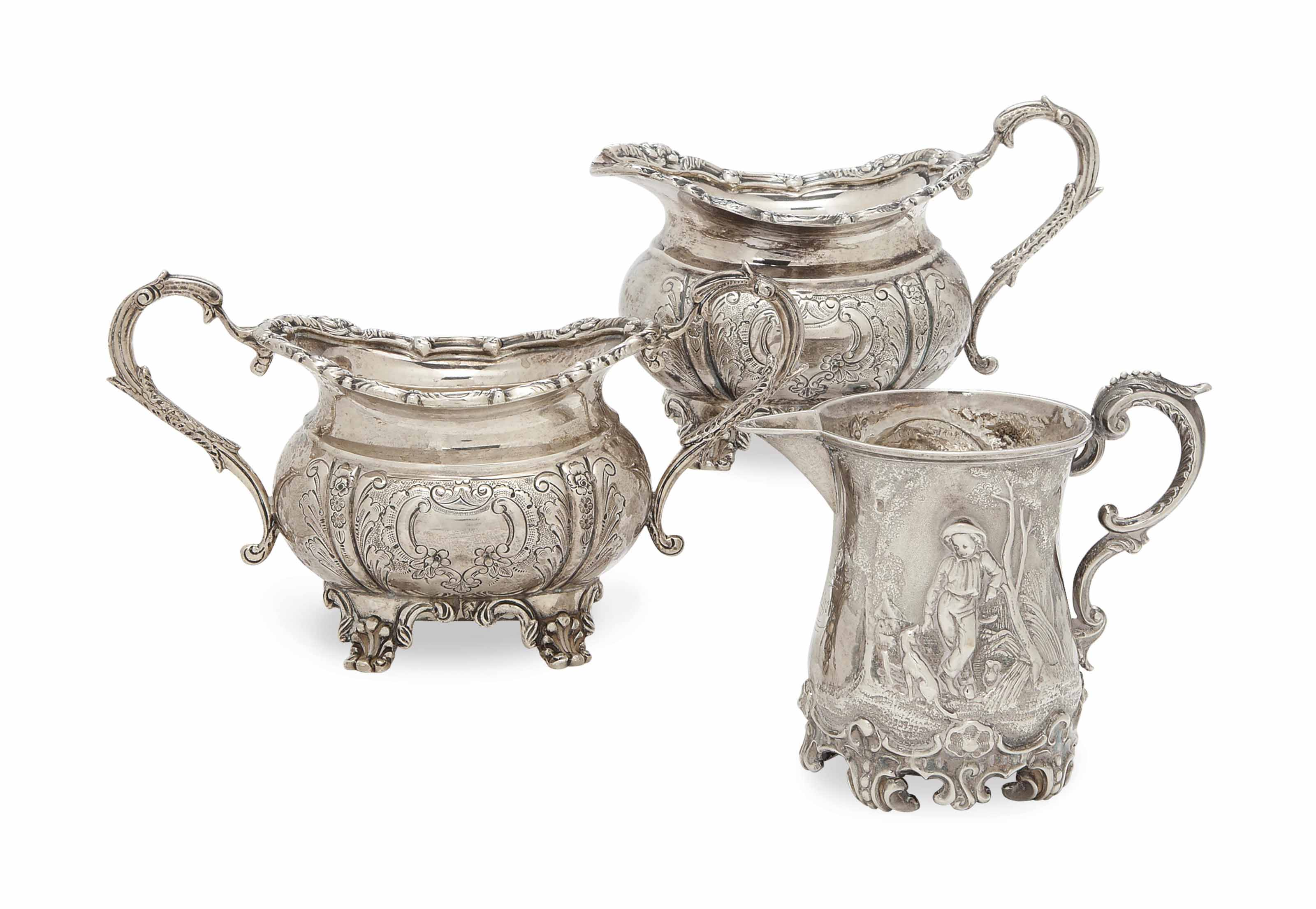 AN ENGLISH SILVER THREE-PIECE TEA SERVICE, AND A REPOUSSE MILK JUG,