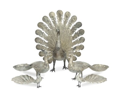 A SILVER FIGURE OF A PEACOCK A