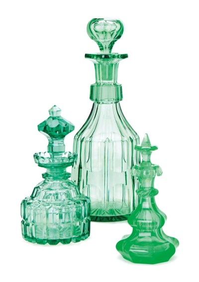 A GREEN CUT GLASS DECANTER AND