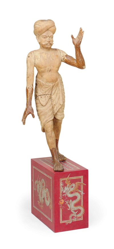 A CARVED-WOOD FIGURE OF A MAN,