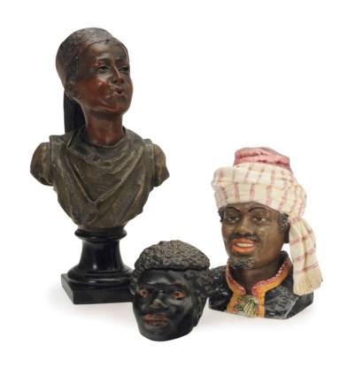 THREE CERAMIC BUSTS OF BLACKAM