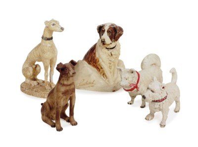A GROUP OF FIVE FIGURES OF DOG