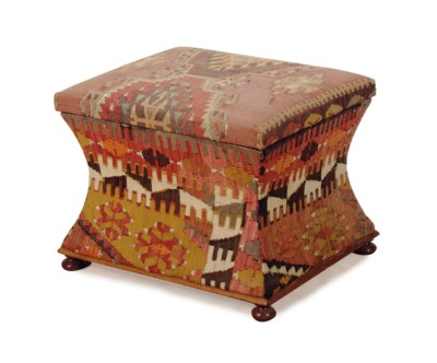 A KILIM-COVERED LIFT-TOP STOOL