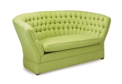 A BUTTON-TUFTED GREEN WOOL-UPH