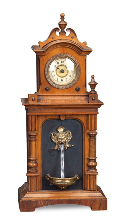 A BRASS-MOUNTED WALNUT FOUNTAI