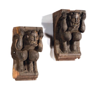 A PAIR OF DARK-STAINED CARVED