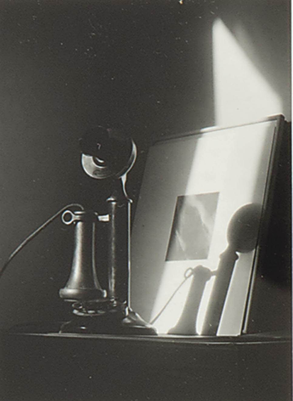 Telephone in front of Alfred Stieglitz 'Equivalent' at An American Place, New York, circa 1940
