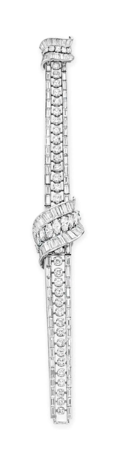 A DIAMOND BRACELET-WATCH, BY O