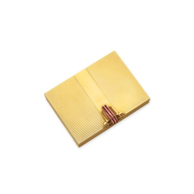 A RUBY AND GOLD COMPACT, BY VA