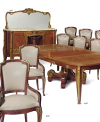 A FRENCH ORMOLU-MOUNTED SATINE AND AMBOYNA EXTENDING DINING TABLE