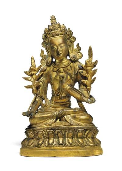 A gilt bronze figure of a bodh
