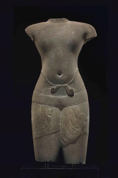 A sandstone torso of a male de