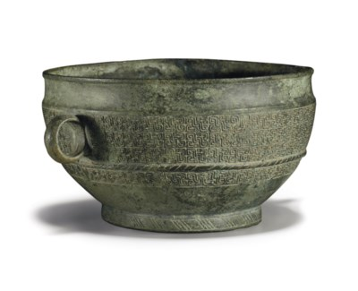 A BRONZE TWO-HANDLED CUP