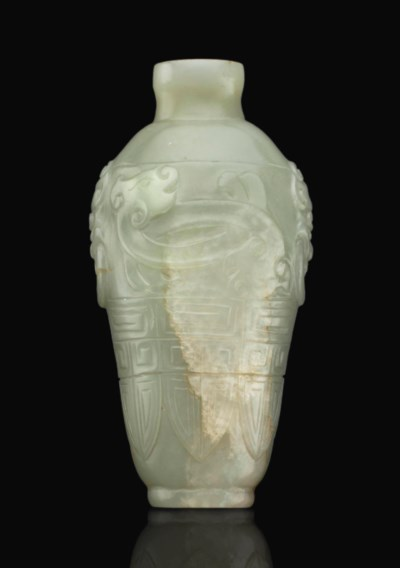 A CARVED PALE GREEN JADE SNUFF