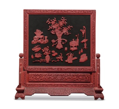 A CARVED RED AND BLACK LACQUER
