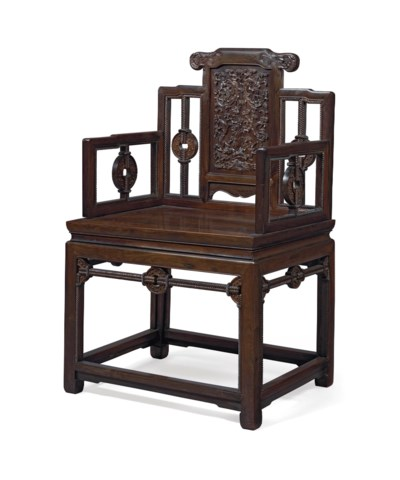 A CARVED ZITAN ARMCHAIR