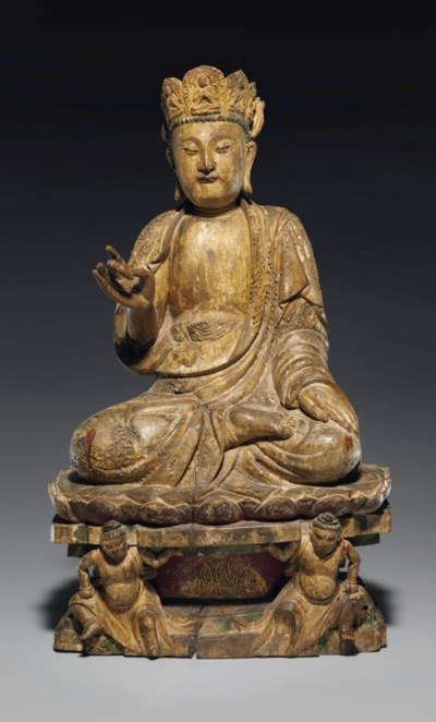 A RARE CARVED WOOD FIGURE OF B