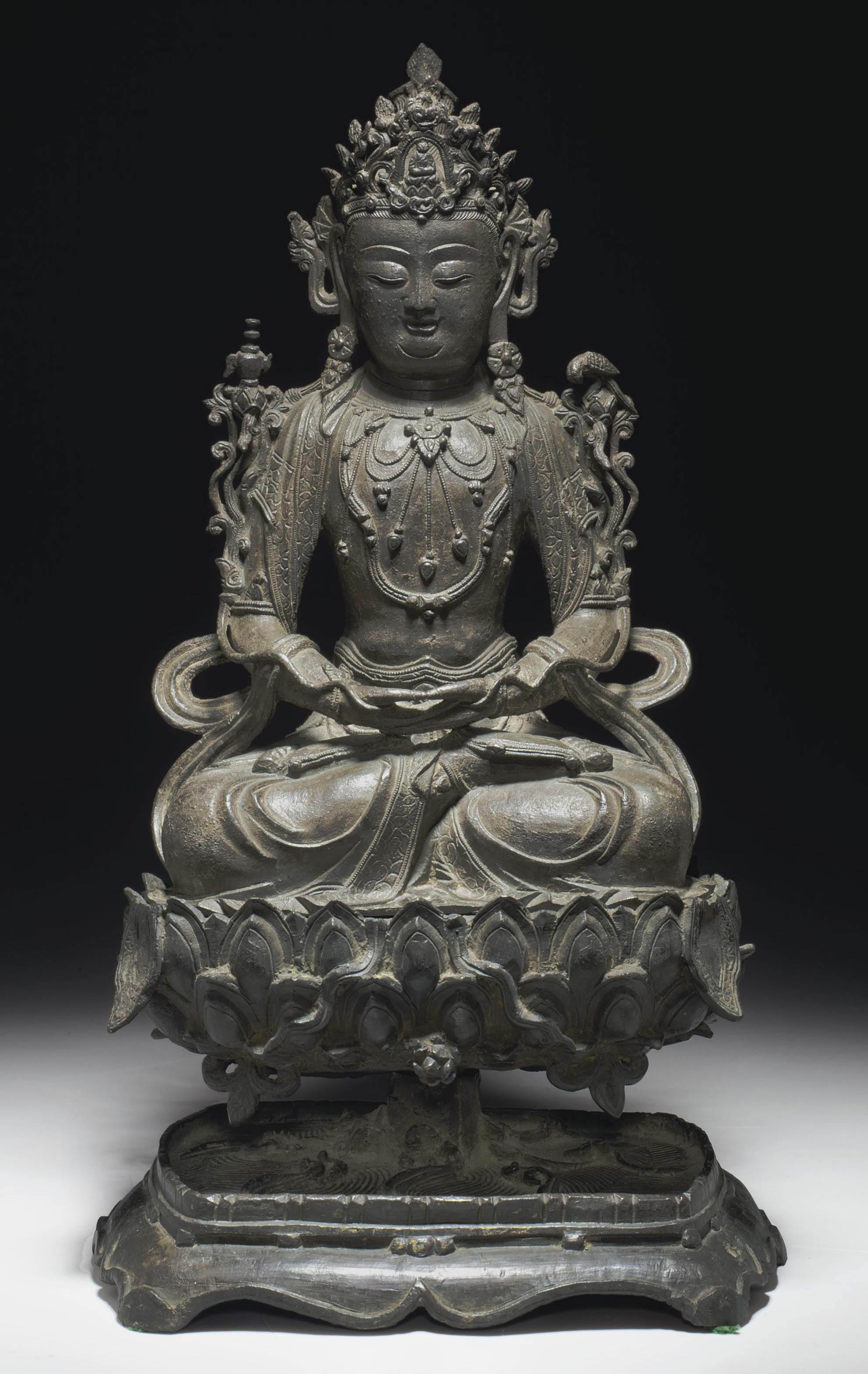 A LARGE BRONZE FIGURE OF GUANY