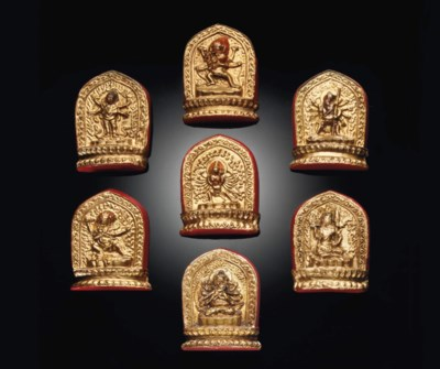 A GROUP OF SEVEN MOLDED AND PA