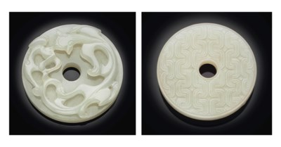A CARVED WHITE JADE ARCHAISTIC
