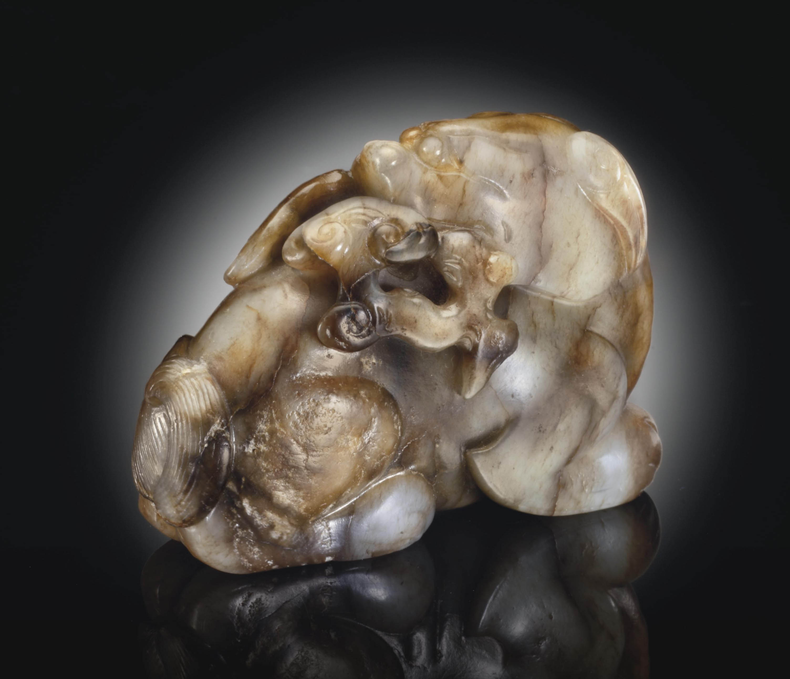 A GREYISH-WHITE AND BROWN JADE