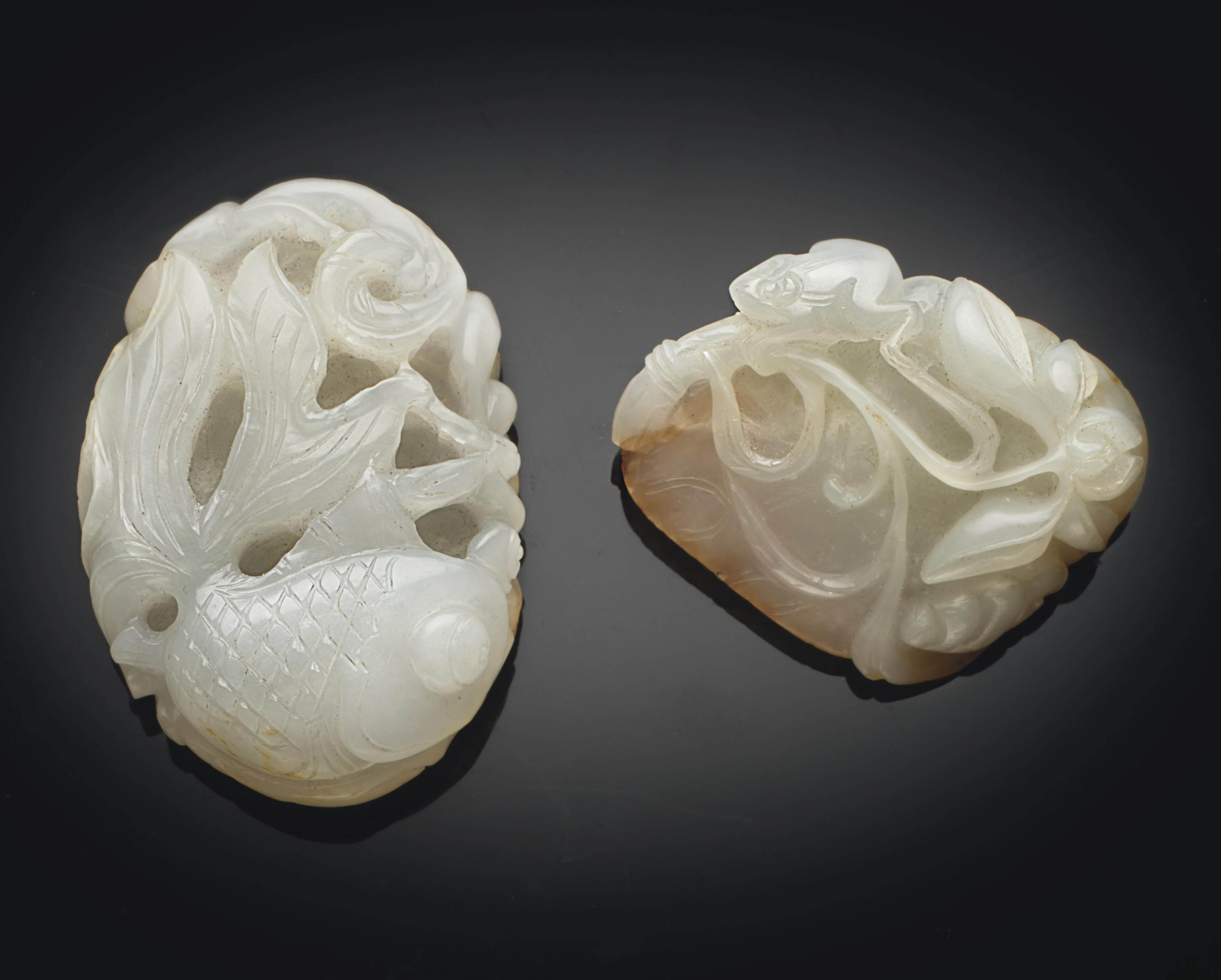 A WHITE JADE PENDANT AND A WHI